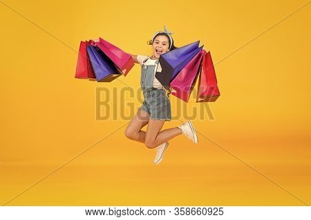 Hurry Up. Buy It Faster. Happy Girl Jump With Shopping Bags. Little Child Smile With Paper Bags. Hol