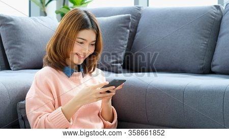 Stay Home, Social Distancing, Happy Young Asian Woman Using Mobile Phone At Home, Asia Girl Smiling