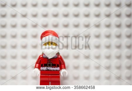 MARCH 30 2020 - Lego style mini figure of Santa Claus against a white lego board