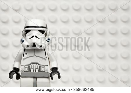 MARCH 30 2020 - Lego style mini figure of an Imperial Stormtrooper against a white Lego board