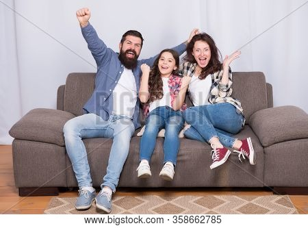 Together We Make Family. Happy Family At Home. Little Child And Parents Celebrate Victory. Protect Y