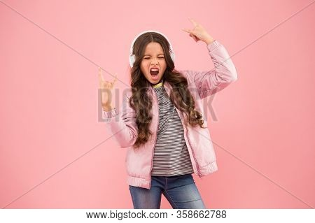 Feel Like A Winner. Small Girl Sing To Song Pink Background. Little Child Do Vocal On Song. Emotiona