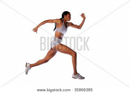 Beautiful fast running female athlete with toned muscular fitness body in grey with headset listening to music while exercising isolated. poster