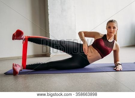 Attractive Fit Young Woman Sport Wear Fitness Girl Doing Stretching With Elastic Band At Loft Studio