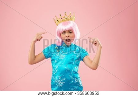 She Is Princess. Capricious Little Princess. Small Girl Pointing Fingers At Crown. Beauty Princess I