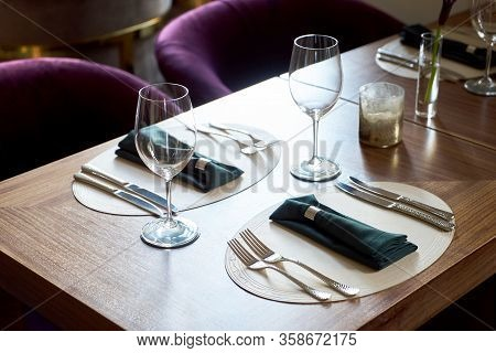Restaurant Table Setting With Empty Clean Glasses. Banquet Dining Table