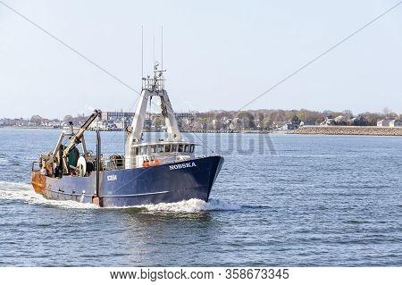 New Bedford, Massachusetts, Usa - April 24, 2019: Commercial Fishing Boat Nobska Homebound On Hazy M