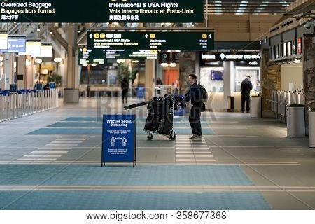 Richmond, Bc, Canada - Mar 29, 2020: Traveller In The International Departures Section Of Yvr Which