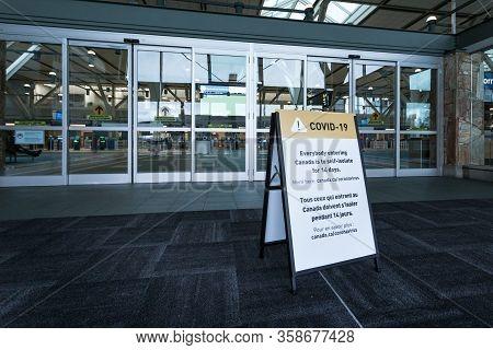 Richmond, Bc, Canada - Mar 29, 2020: A Public Health Notice Sign At Yvr Advising Returning Traveller