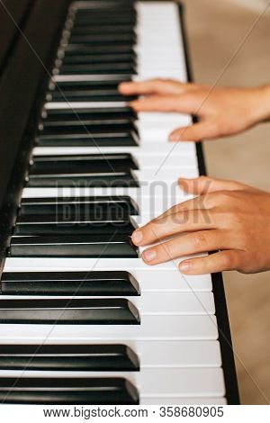 The Child Hands Playing Piano Stock Photo