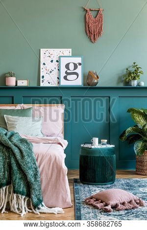Stylish Composition Of Bedroom Interior With Wooden Bed, Design Furnitures, Shelf And Elegant Person