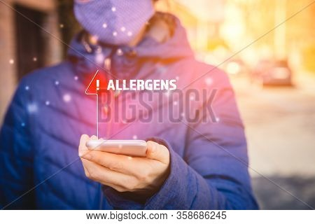 Increased Concentration Of Allergens And Polls In The Air. Woman With Mask And Smart Phone With Noti