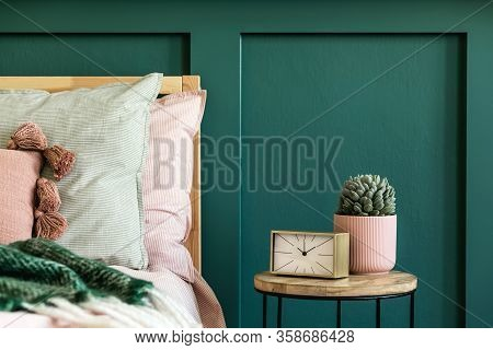Stylish Composition Of Bedroom Interior With Wooden Bed, Design Furnitures, Golden Clock And Succule