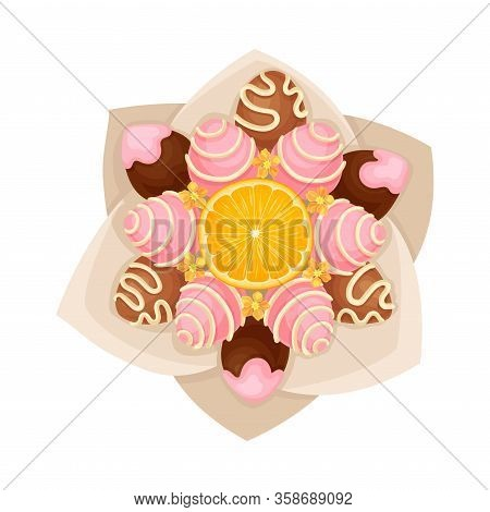 Bouquet Of Sweets Chocolate And Caramel Covered With Orange Slice In The Middle In Paper Wrap View F