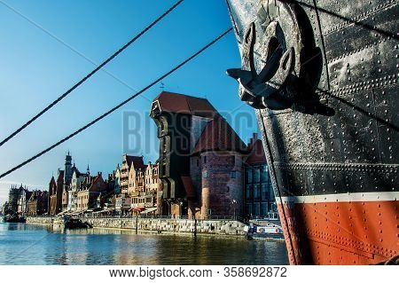 Famous Historic Medieval Port Crane - One Of The Gdańsk Water Gates. Sunny Morning On The Motlava Ri