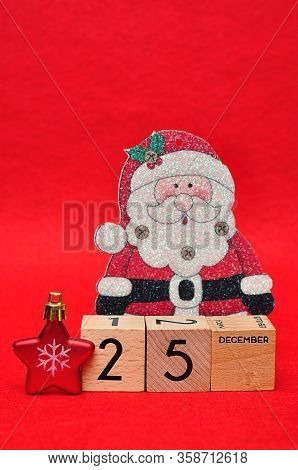 25 December On Wooden Blocks With A Red Star And A Christmas Father On A Red Background