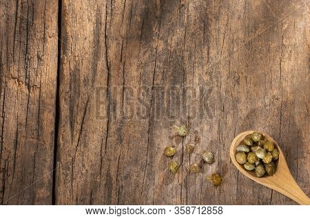 Capers In Wooden Spoon - Capparis Spinosa