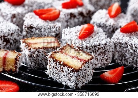 Traditional Vanilla Sponge Mini Cakes With Strawberry Jam Layer Inside, Coated With Chocolate And De