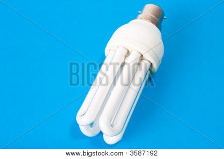 Energy Saving Bulb On Blue Background