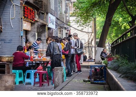 Chongqing, China - May 10, 2019 : People Buy Street Food On The Street In Chongqing, China. Street F