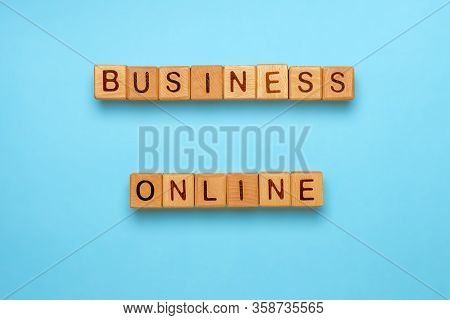 Business Online Made With Wooden Cubes On Blue Background. Rethink Your Business By Expandng Busines
