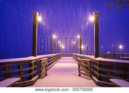 Fishing Pier Winter Snow Richmond Bc. A Snow Storm Blankets A Fishing Pier On The Bank Of The Fraser