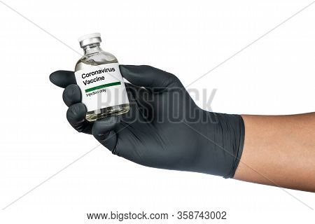 Hand Of Medical Doctor Or Virologist Holding Bottle Vaccination Or Tube With Ncov Coronavirus Vaccin