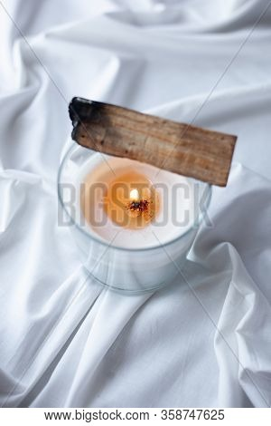 Smudging Ceremony. Peruvian Palo Santo Holy Wood With A White Burning Candle. Esoteric Objects For M