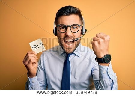 Business operator man with customer service headset from call center offering help and support annoyed and frustrated shouting with anger, crazy and yelling with raised hand, anger concept