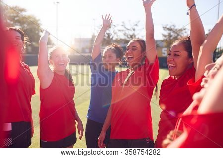 Manager Breaking From Huddle With Womens Football Team After Pep Talk Before Soccer Match