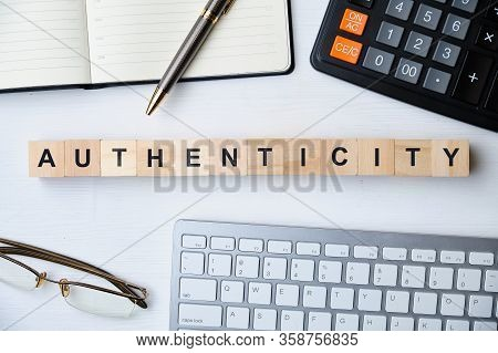 Modern Business Buzzword - Authenticity. Top View On Wooden Table With Blocks. Top View. Close Up.
