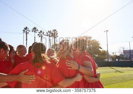 Womens Football Team In Huddle Having Motivational Pep Talk Before Soccer Match