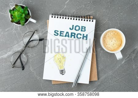 Notebook With Glasses And Coffee On The Marble Table. Business Recruit Hire Concept. Flat Lay On Iso
