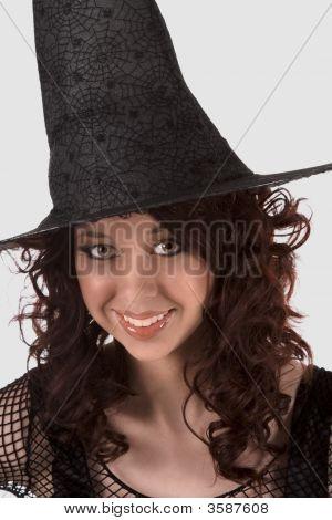 Dark Portrait: Smiling Teen Girl In Halloween Hat