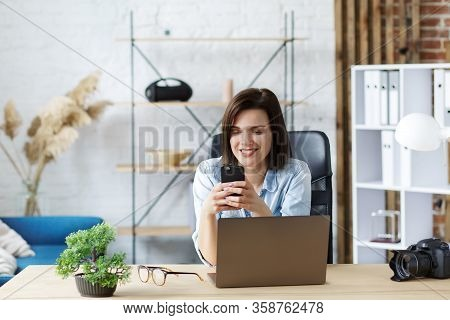 Working From Home.communication Online With Colleagues And Freelancers.portrait Of Young Woman Using