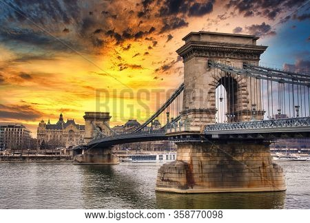Chain Bridge On Danube River In Budapest City In Hungary. Urban Landscape Panorama With Old Building