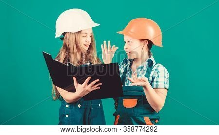 Small Girls Repairing Together In Workshop. Labor Day. 1 May. School Project. Happy Children. Little