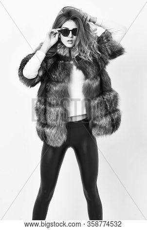 Female Brown Fur Coat. Fur Store Model Enjoy Warm In Soft Fluffy Coat With Collar. Woman Wear Sungla