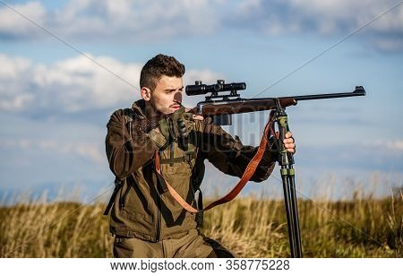 Hunter With Hunting Gun And Hunting Form To Hunt. Hunter Is Aiming. Hunter Man. Shooter Sighting In