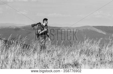 Man Brutal Gamekeeper Nature Landscape Background. Regulation Of Hunting. Hunter Hold Rifle. Nice Da