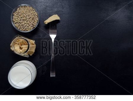 Healthy Eating. Soy Products Soy Tofu Leather Soy Milk In Glass Jars And A Glass On A Dark Slate Bac
