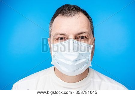 Adult Man In Aseptic Mask In Close-up.