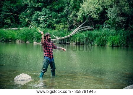 Elegant Bearded Brutal Hipster Man Fishing. Fish On Hook. Catch Me If You Can. Nice Day For Fishing.