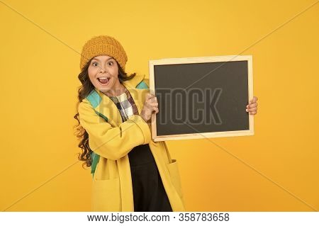Your Advertising Gets On Top. Happy Small Child Hold Advertising Board Yellow Background. Little Gir