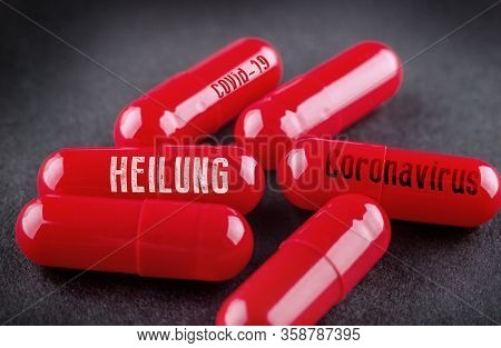 Concept Picture Of A Cure For Coronavirus Covid-19. Heilung Means Cure In German.
