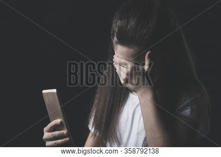 Young Sad Vulnerable Girl Using Mobile Phone Scared And Desperate Suffering Online Abuse Cyberbullyi