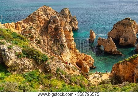 Lagos, Portugal - 6 March 2020: Tourists Visiting Ponta Da Piedade