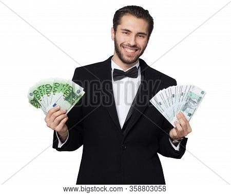 Shark Of Capitalism. Young Male Businessman Is Happy Showing Money, Rubles And Euros