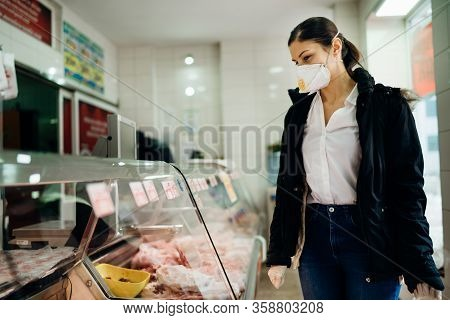 Woman With Protective Mask Shopping For Supplies.budget Shopping.buying Fresh Meat At A Butchery.bee