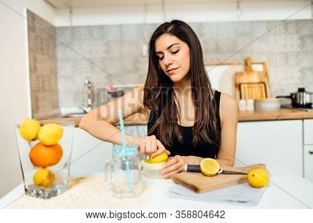 Healthy Cheerful Woman Drinking Homemade Organic Mixed Citrus Fruit Drink.making Lemonade.detox Diet
